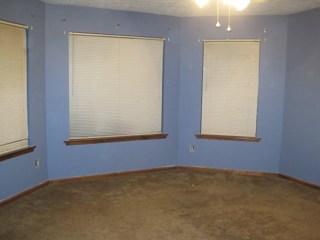 master bedroom original blue walls and brown carpet