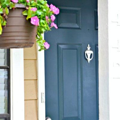 front exterior blue door and hanging basket