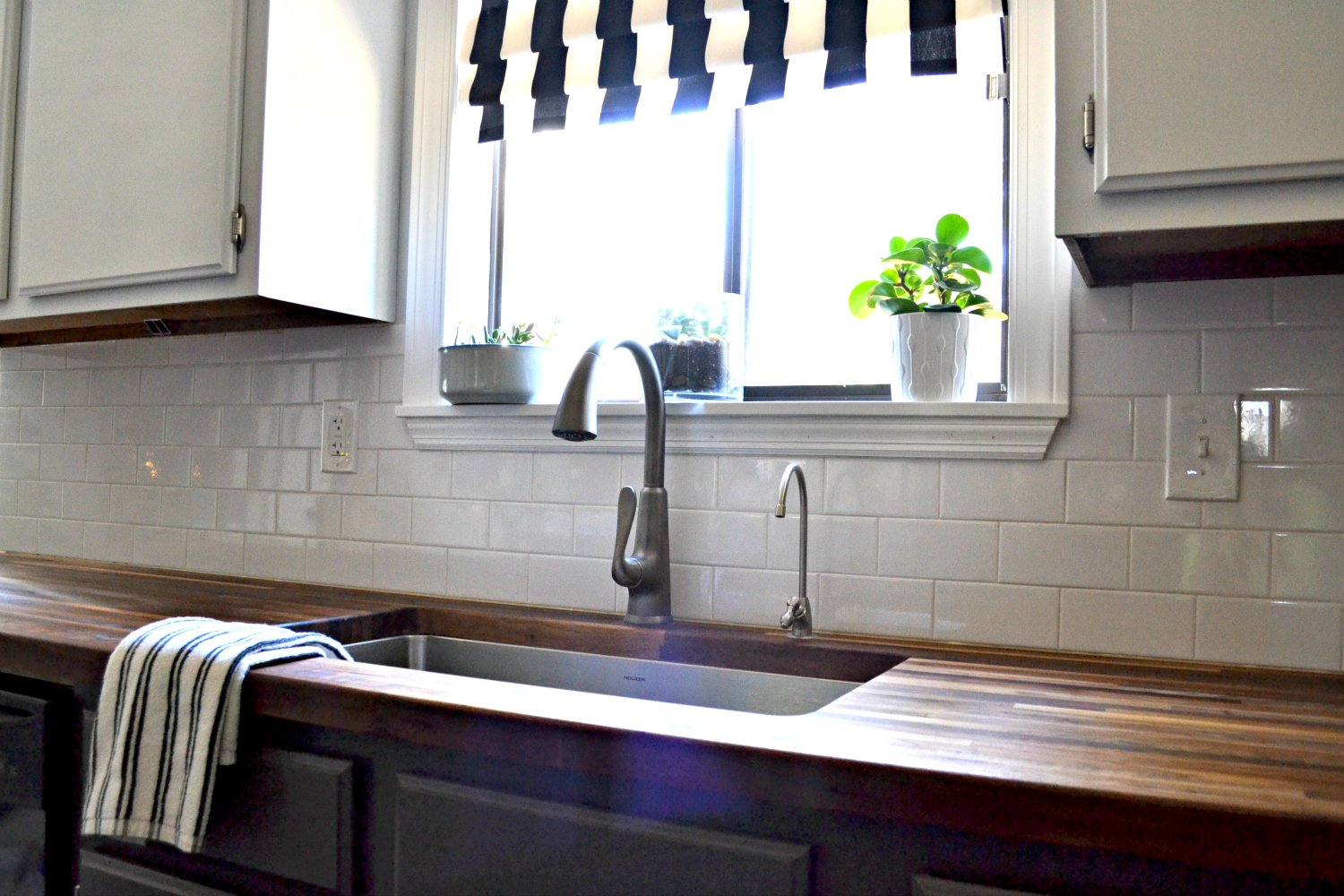 kitchen sink closeup with butcher block counters