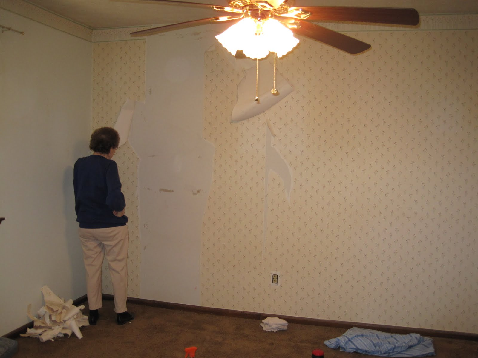 Granny helping take down wallpaper
