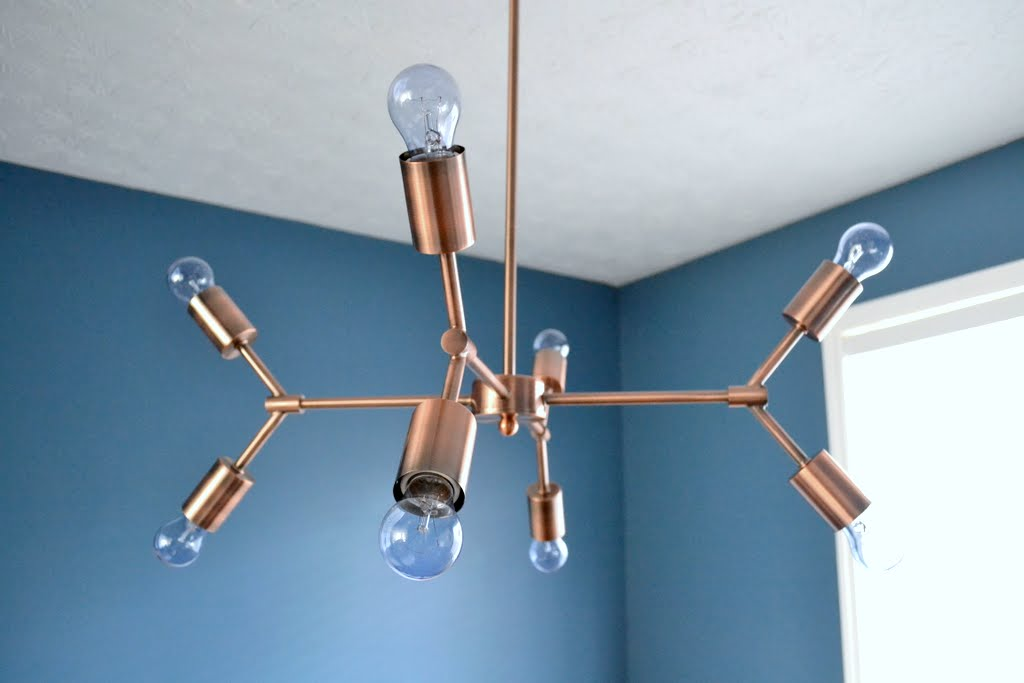 Copper Light Fixture In The Dining Room