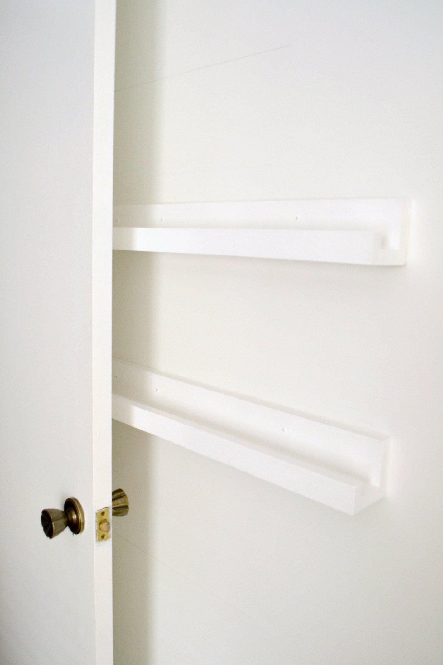 blank diy storage shelves behind the door