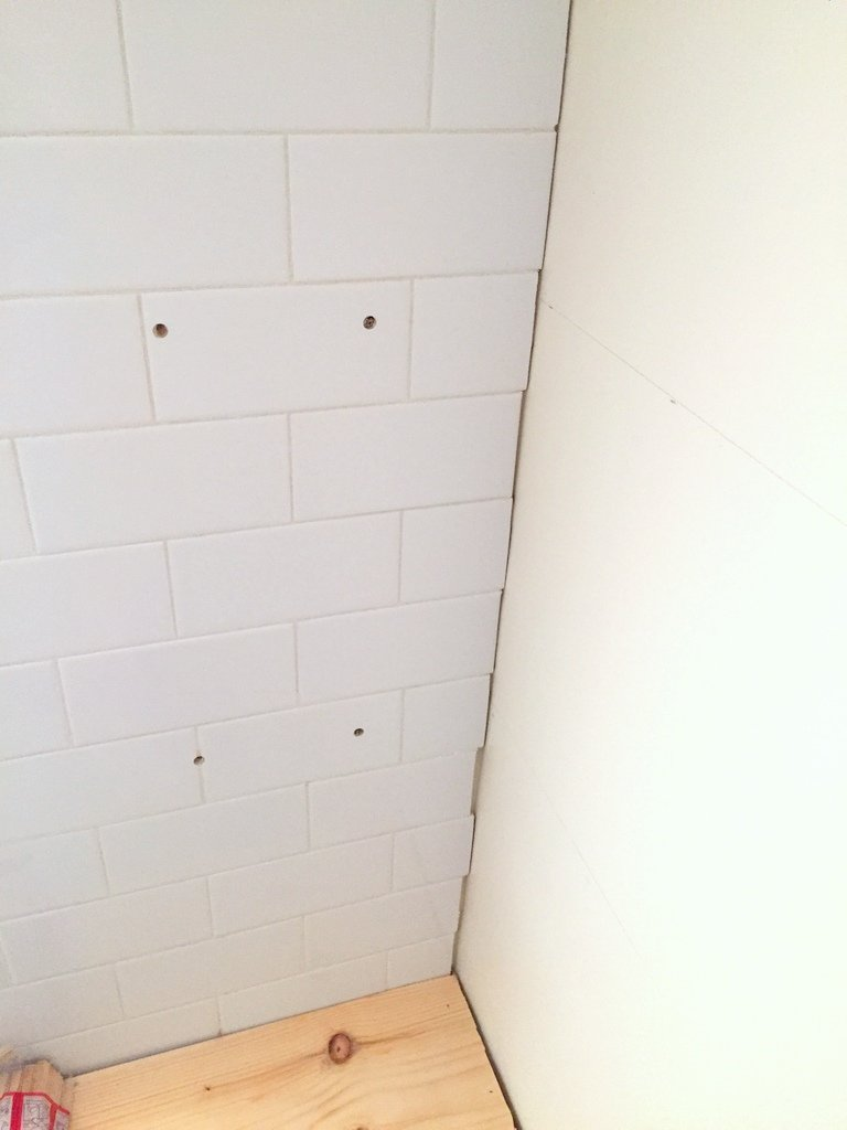 How to install floating shelves on a tile wall using wall anchors how to drill into tile for wall anchors dailygadgetfo Choice Image