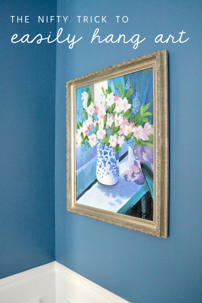 framed flower art on blue wall