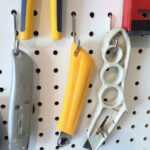 how to secure loose pegboard hooks
