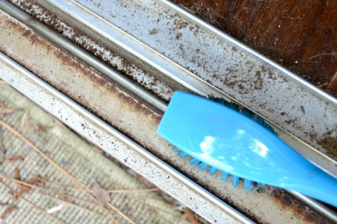 scrub dirty sliding door track