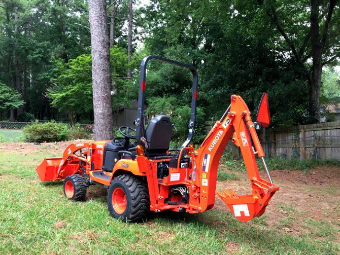 Kubota tractor loader backhoe back yard makeover