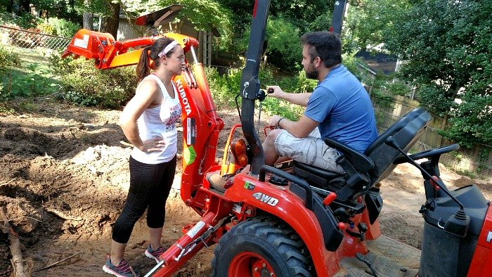 going through instructions on the backhoe