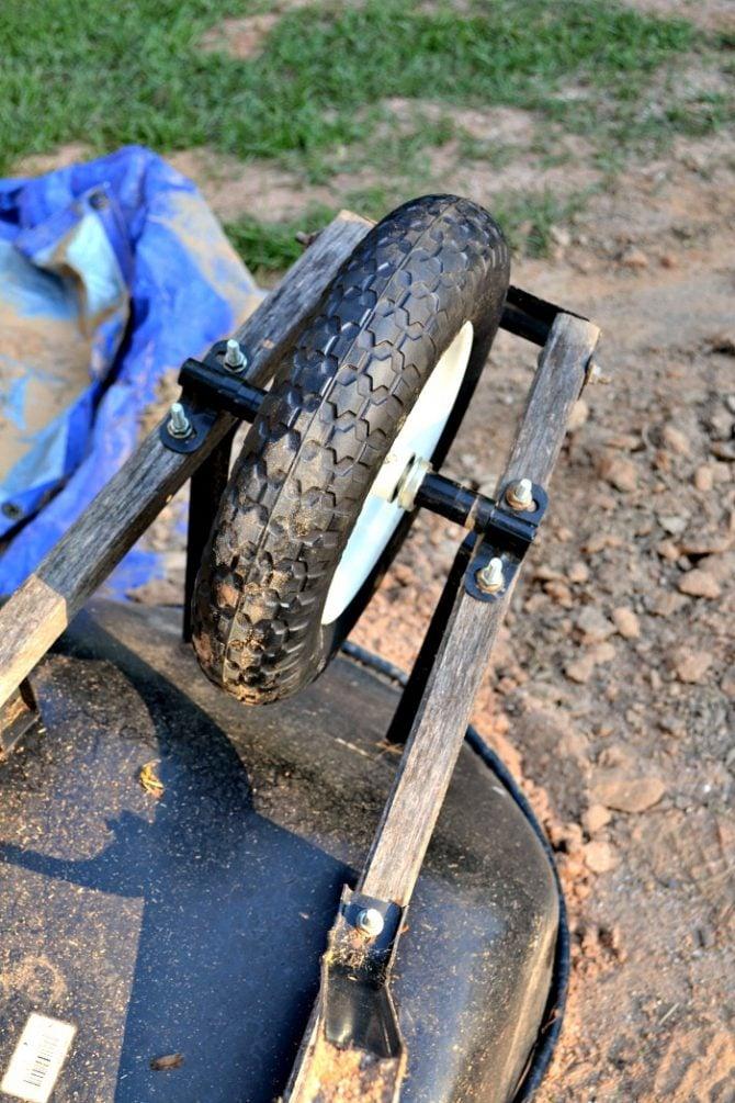 adding new universal flat free tire to wheelbarrow