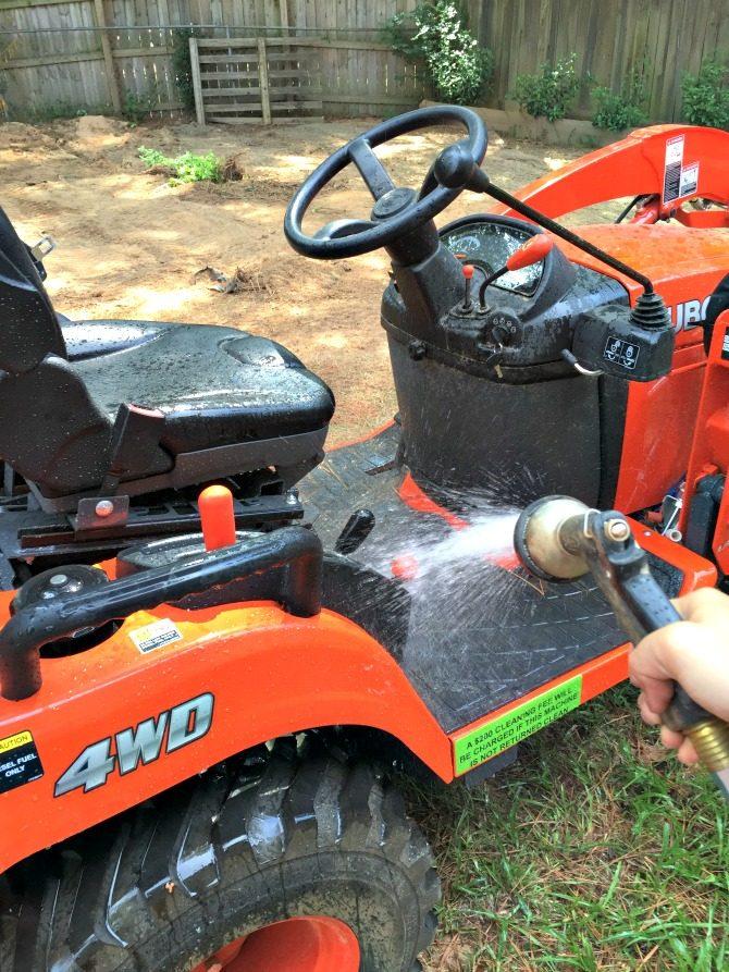 hosing-down-the-equipment