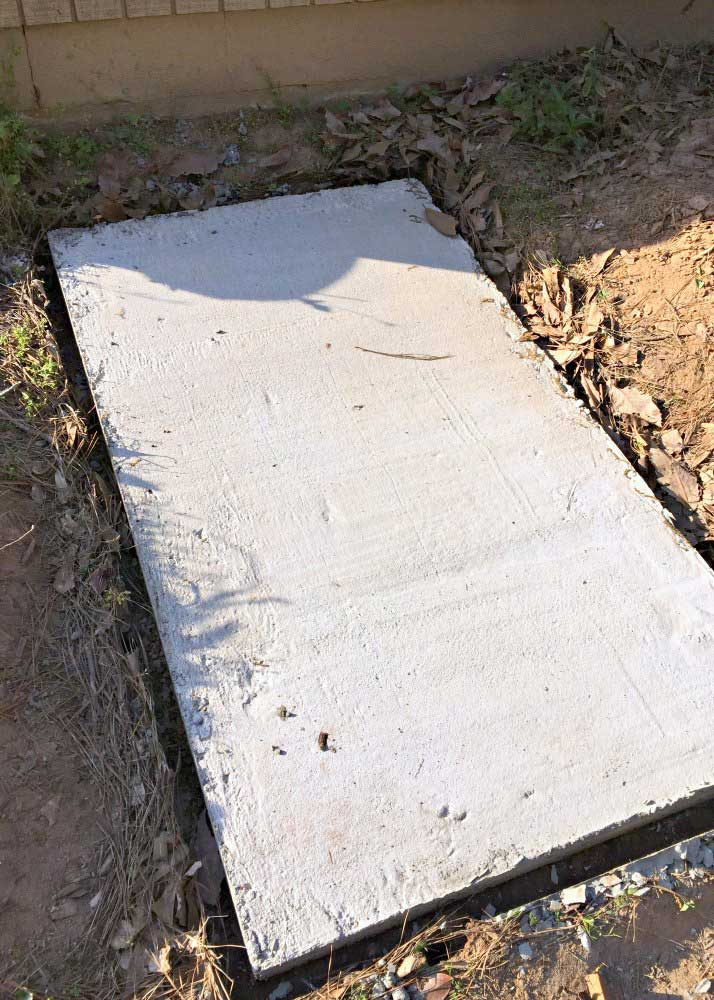 DIY concrete slab on the side of the house
