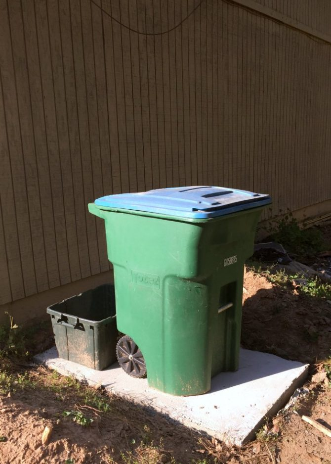 DIY concrete slab for trash bins