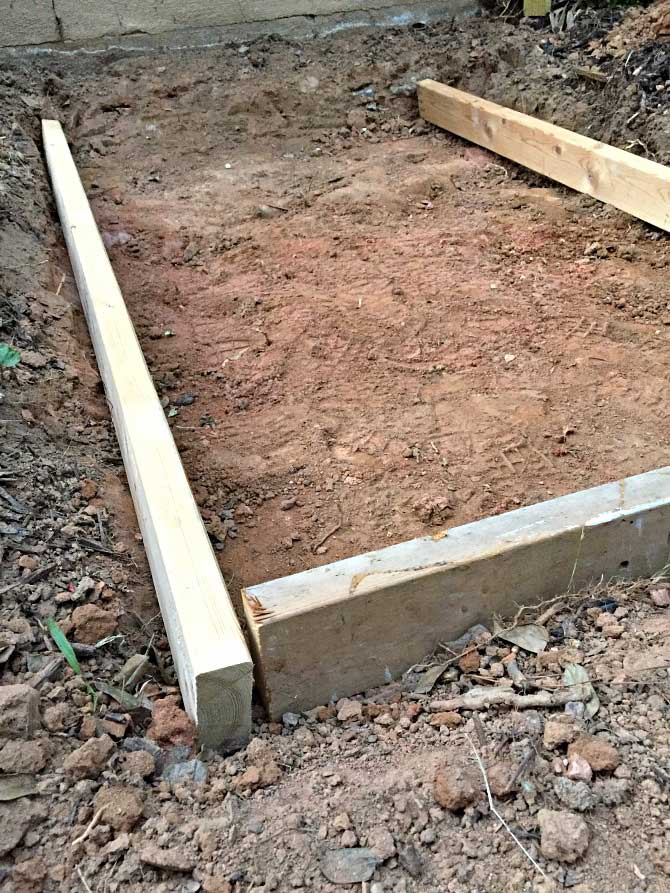 2x4 frame for concrete slab next to house