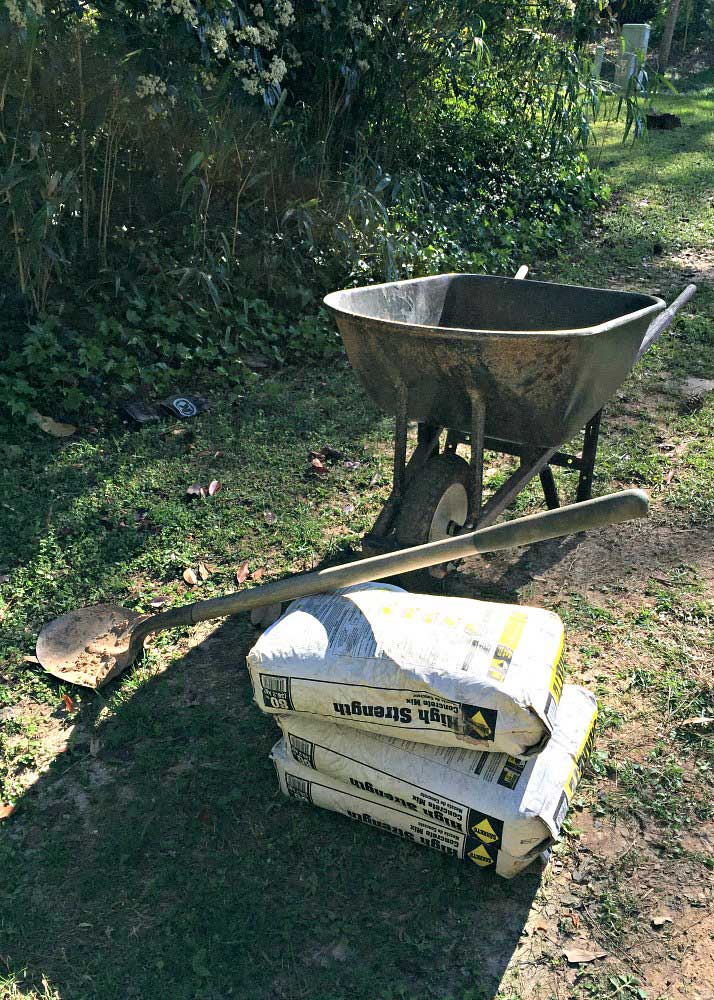 wheelbarrow and bags of concrete