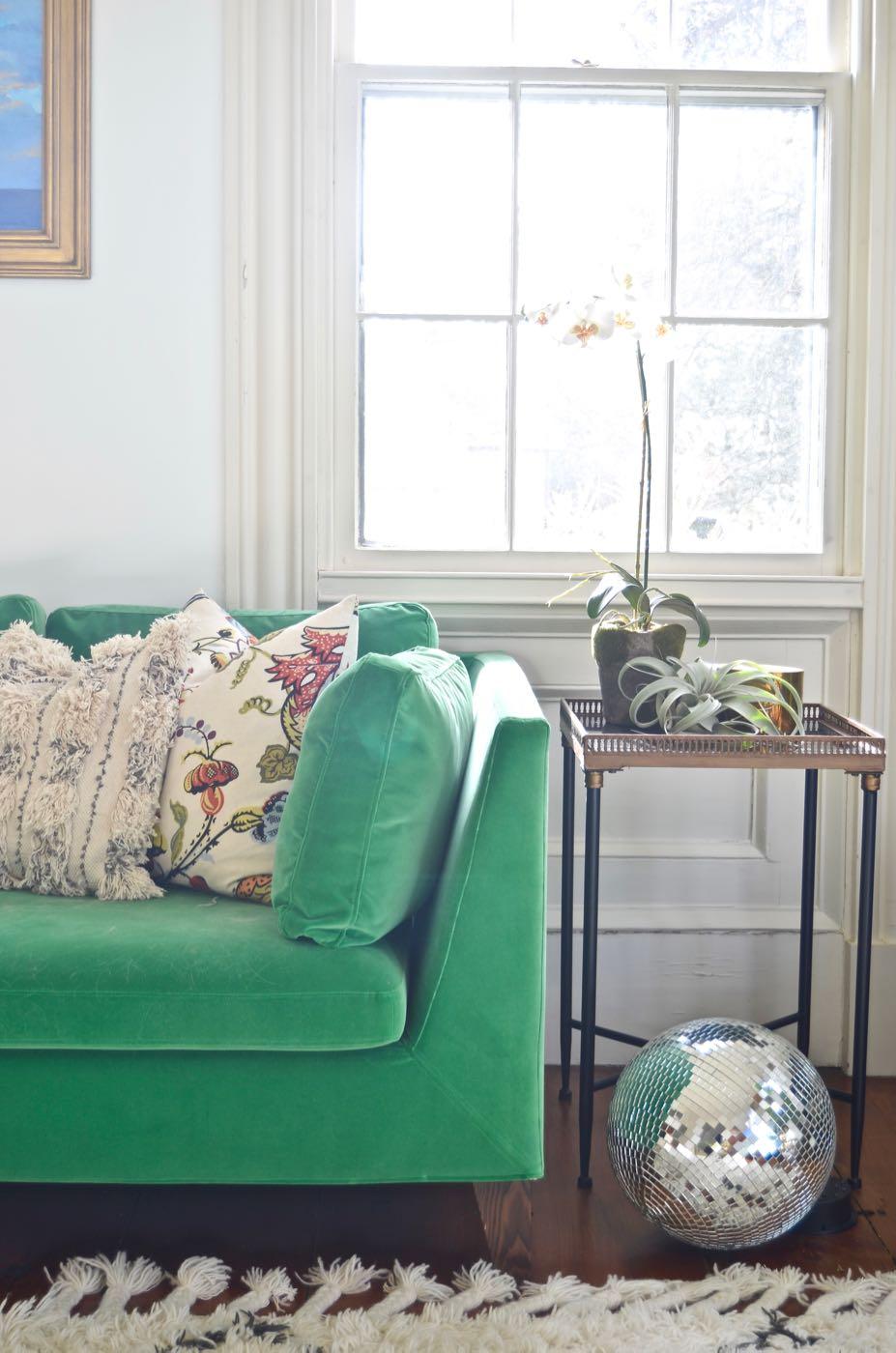 Charlotte's green velvet couch