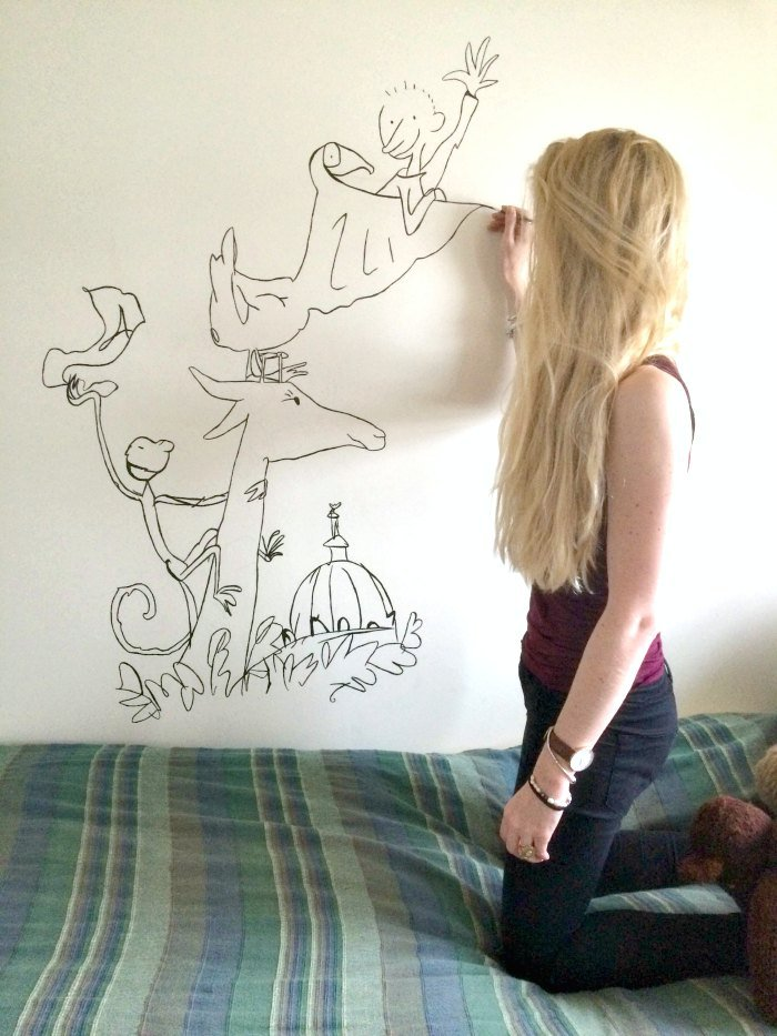 Ruth painting mural for childrens bedroom
