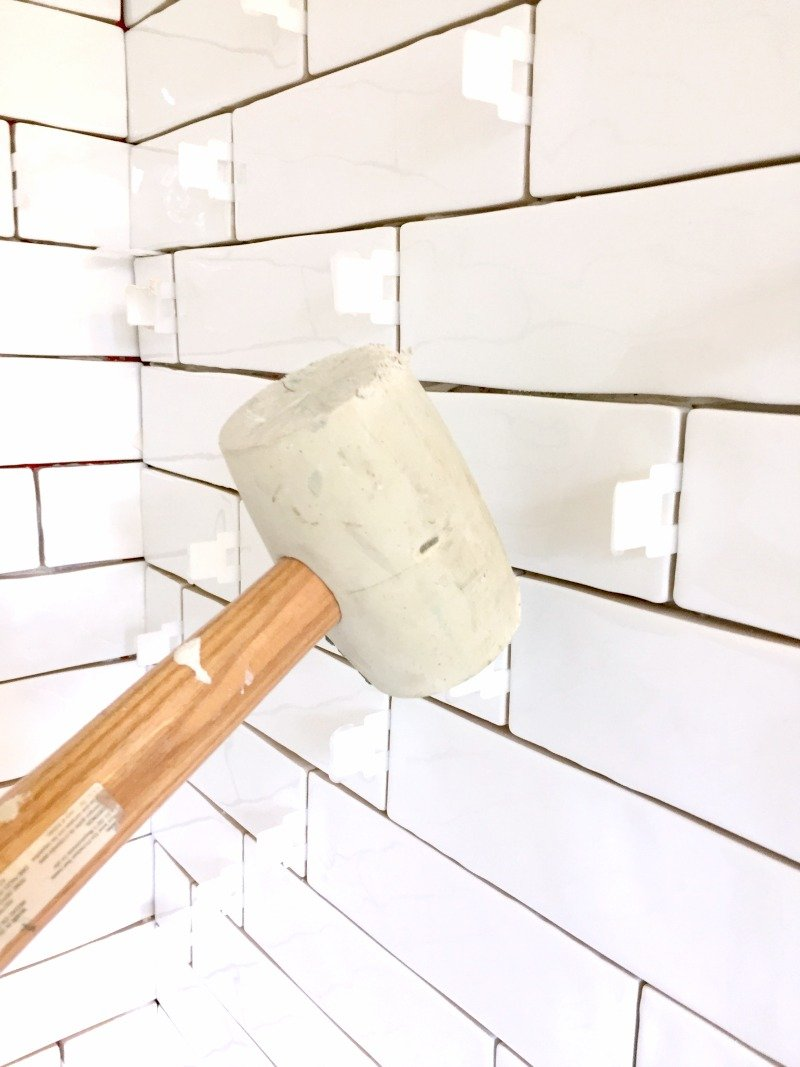 Removing tile leveling spacers with rubber mallet