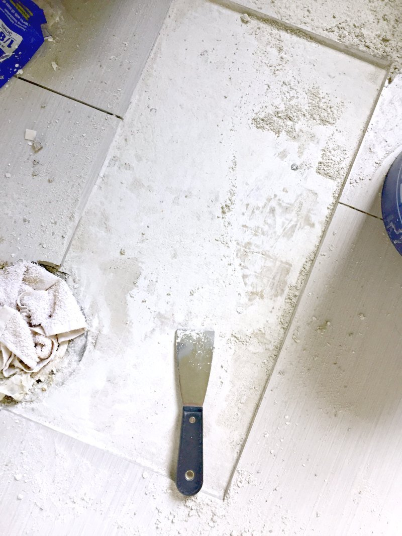 How to replace a porcelain floor tile the ugly duckling house bathroom floor with dried tile adhesive dailygadgetfo Gallery