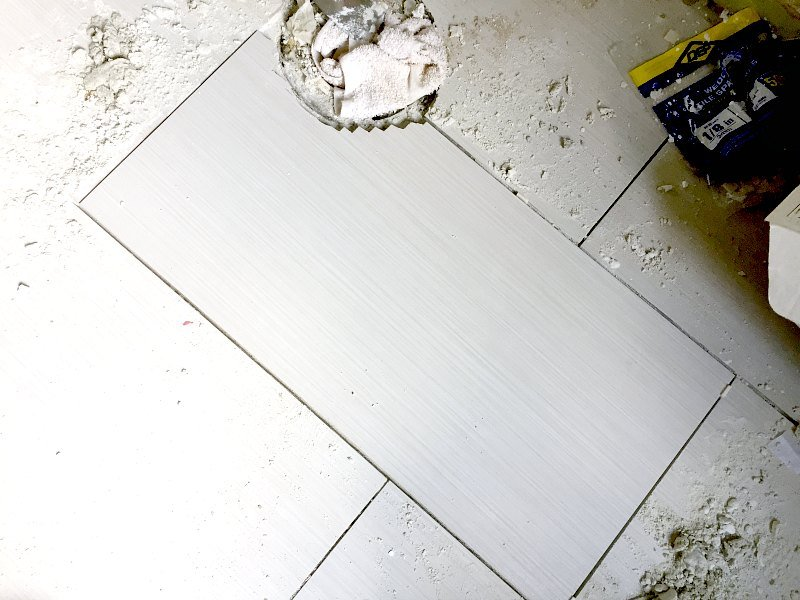 replace porcelain floor tile in master bath