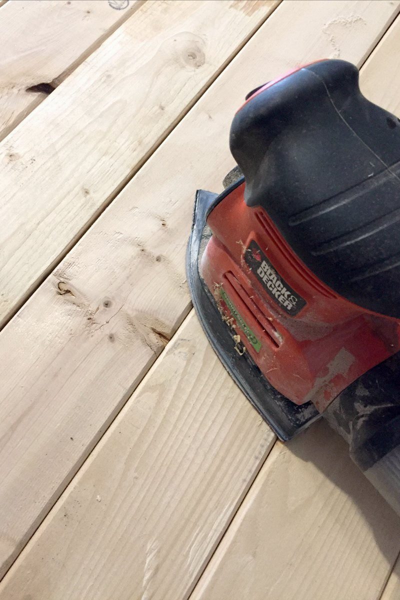 sanding coffee table with palm sander