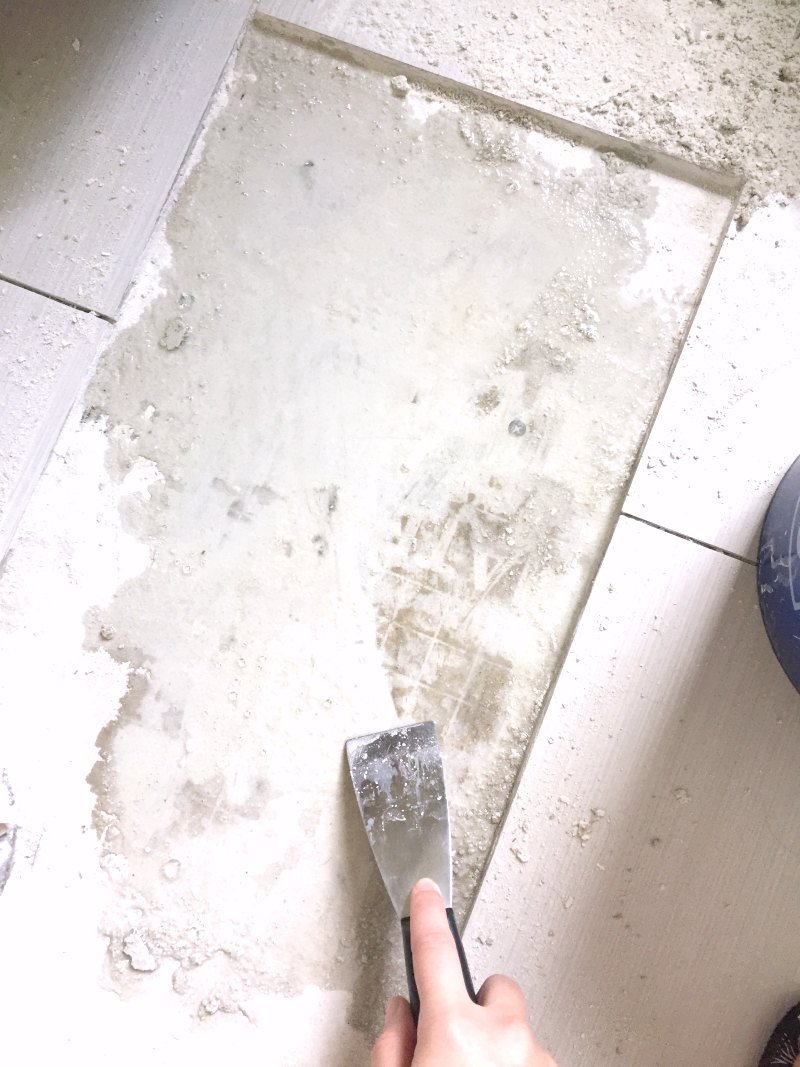 scraping wet tile adhesive from removed tile