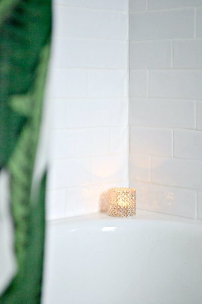 white shower tile with green palm leaf shower curtain