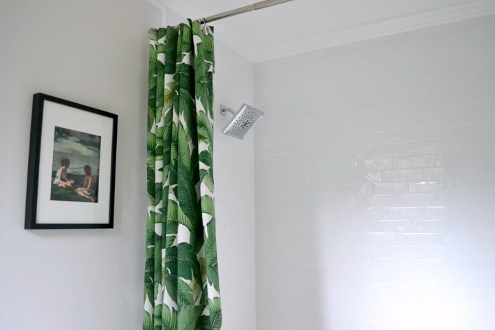 master bathroom shower renovation white subway tile green shower curtain