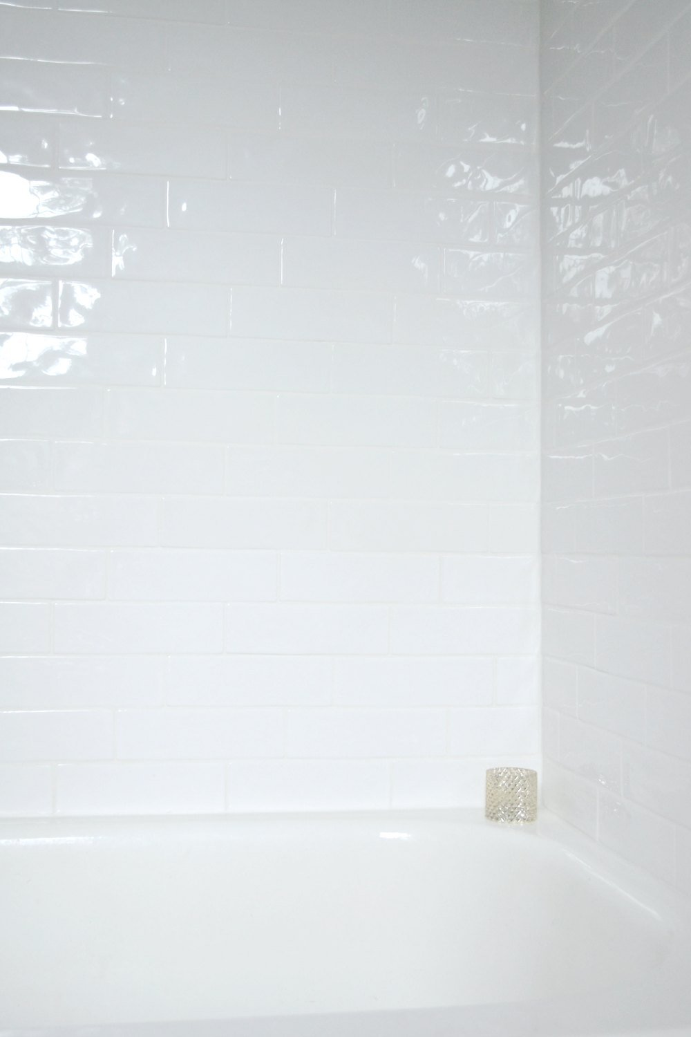 white reflection along handcrafted white tile
