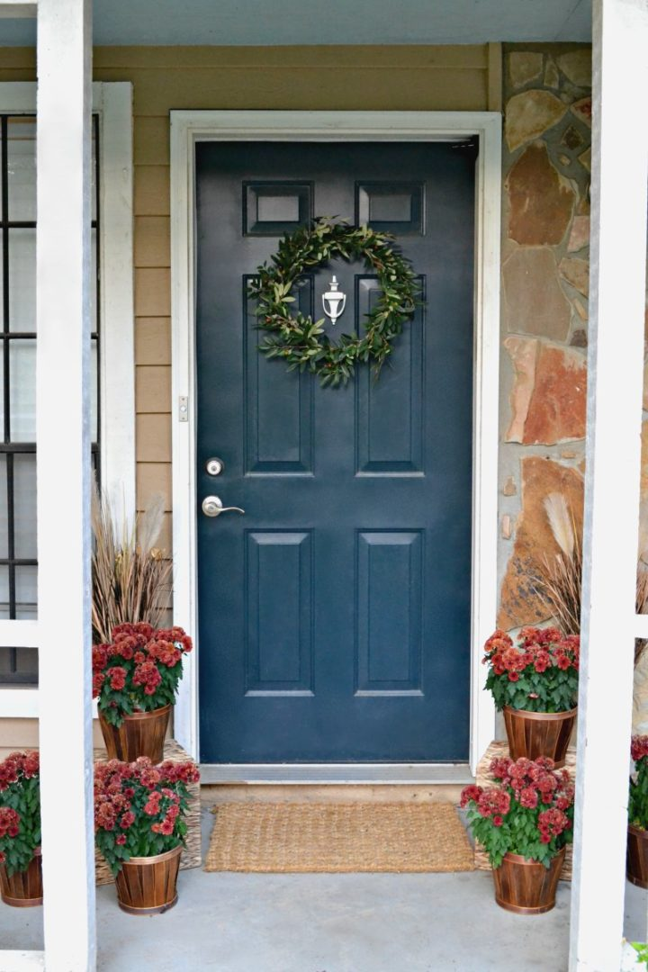 blue front door with red mums - fall house tour