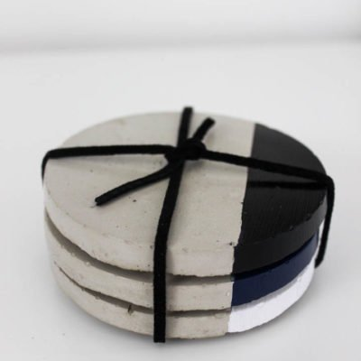 Make your own chic concrete coasters in less than an hour! This quick tutorial will show you how to make your own modern coasters without the big price tag!