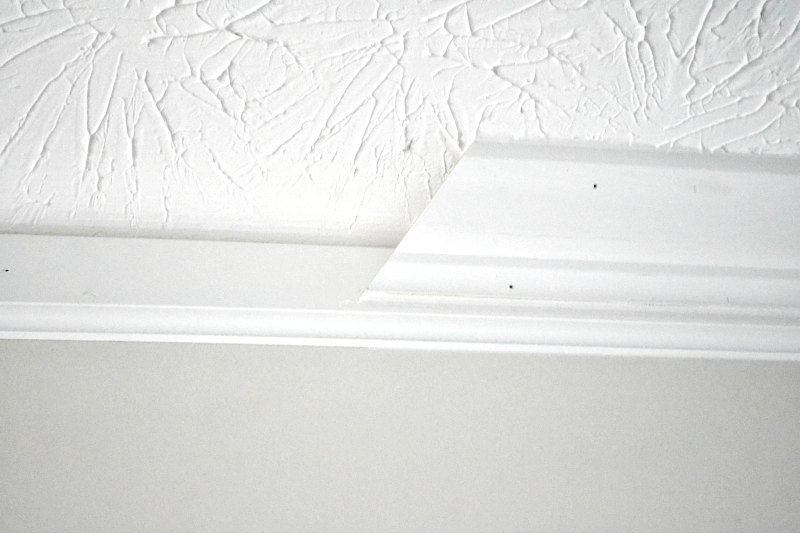 baseboard with crown on top