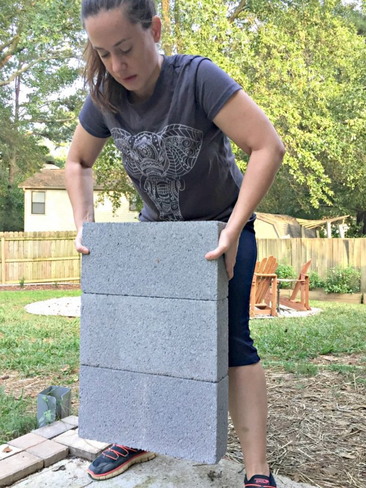 testing the strength of Krazy Glue by gluing concrete blocks together
