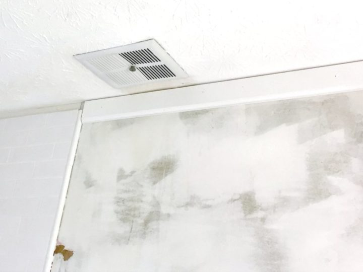 upside down baseboard next to tiled shower