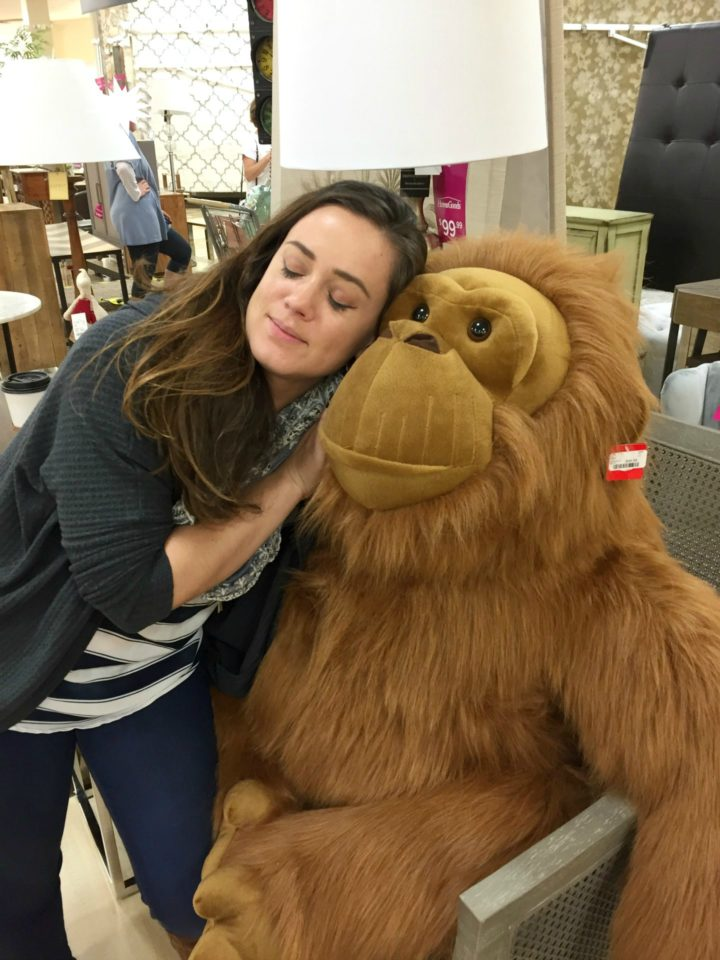 Hugging giant stuffed ape at Homegoods
