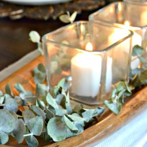 eucalyptus and candle holders in dough bowl
