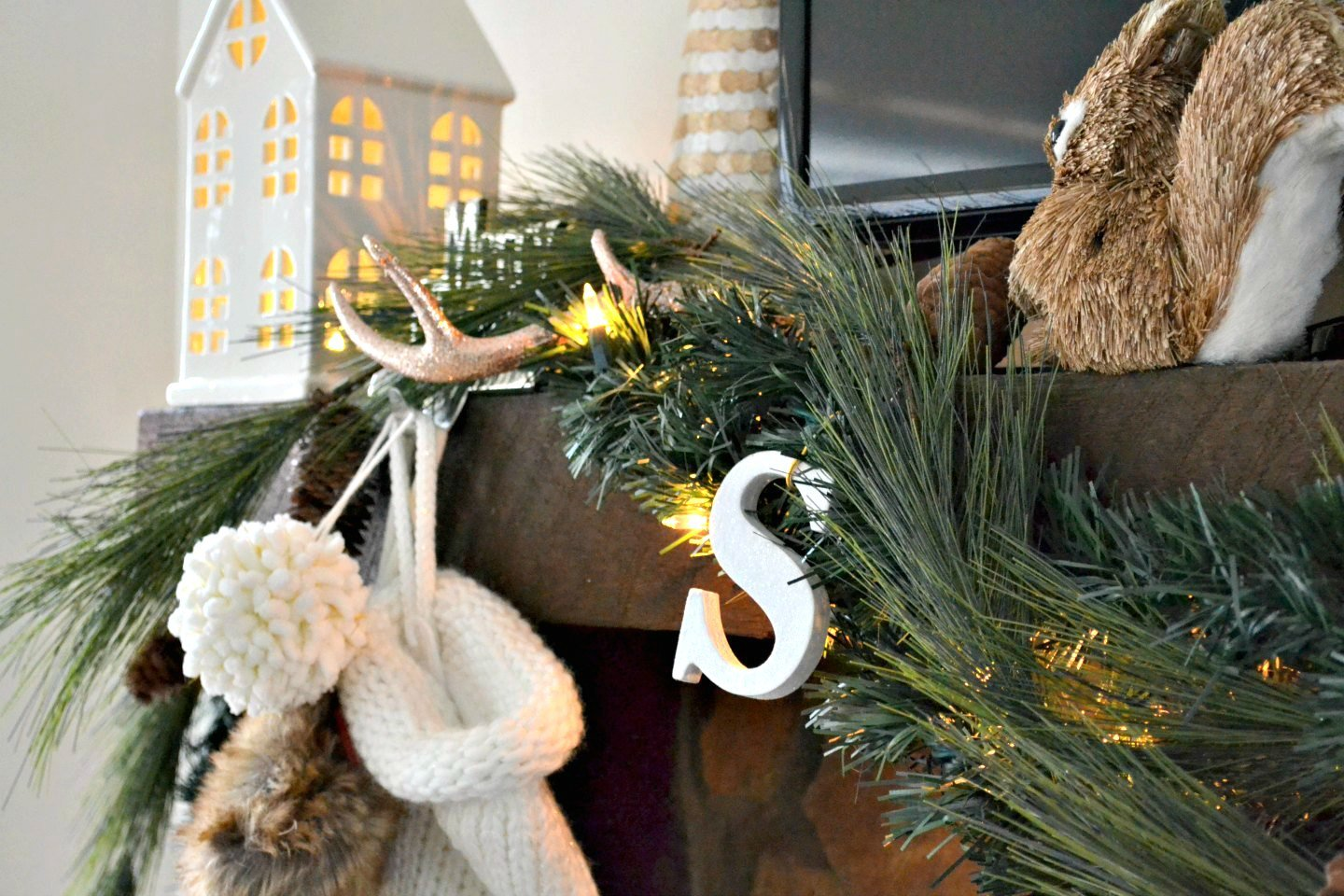 closeup of neutral Christmas mantel with white and gold