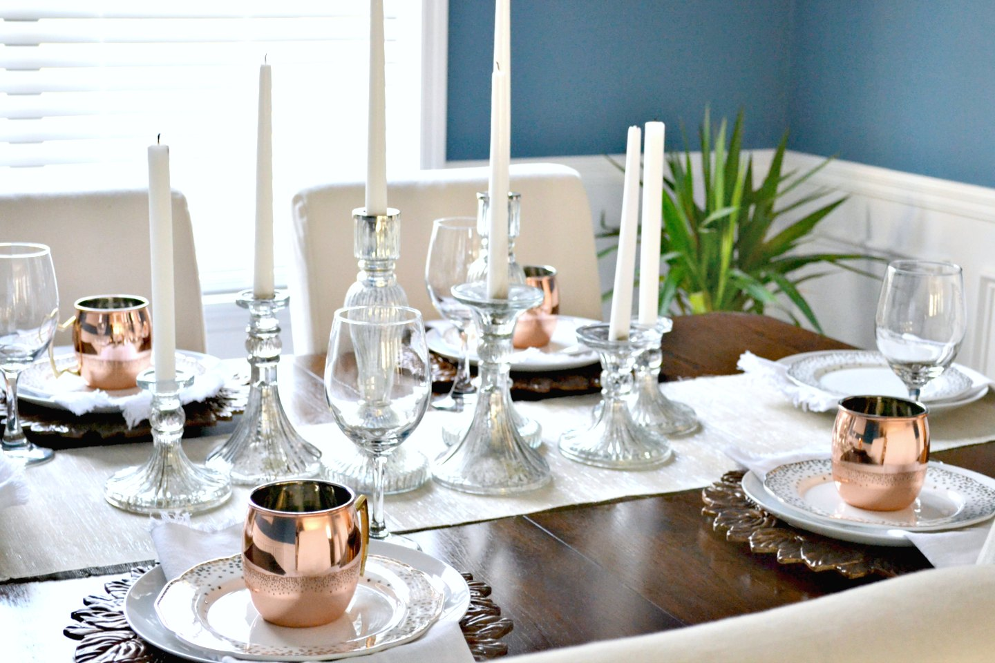dining room Christmas table with copper accents