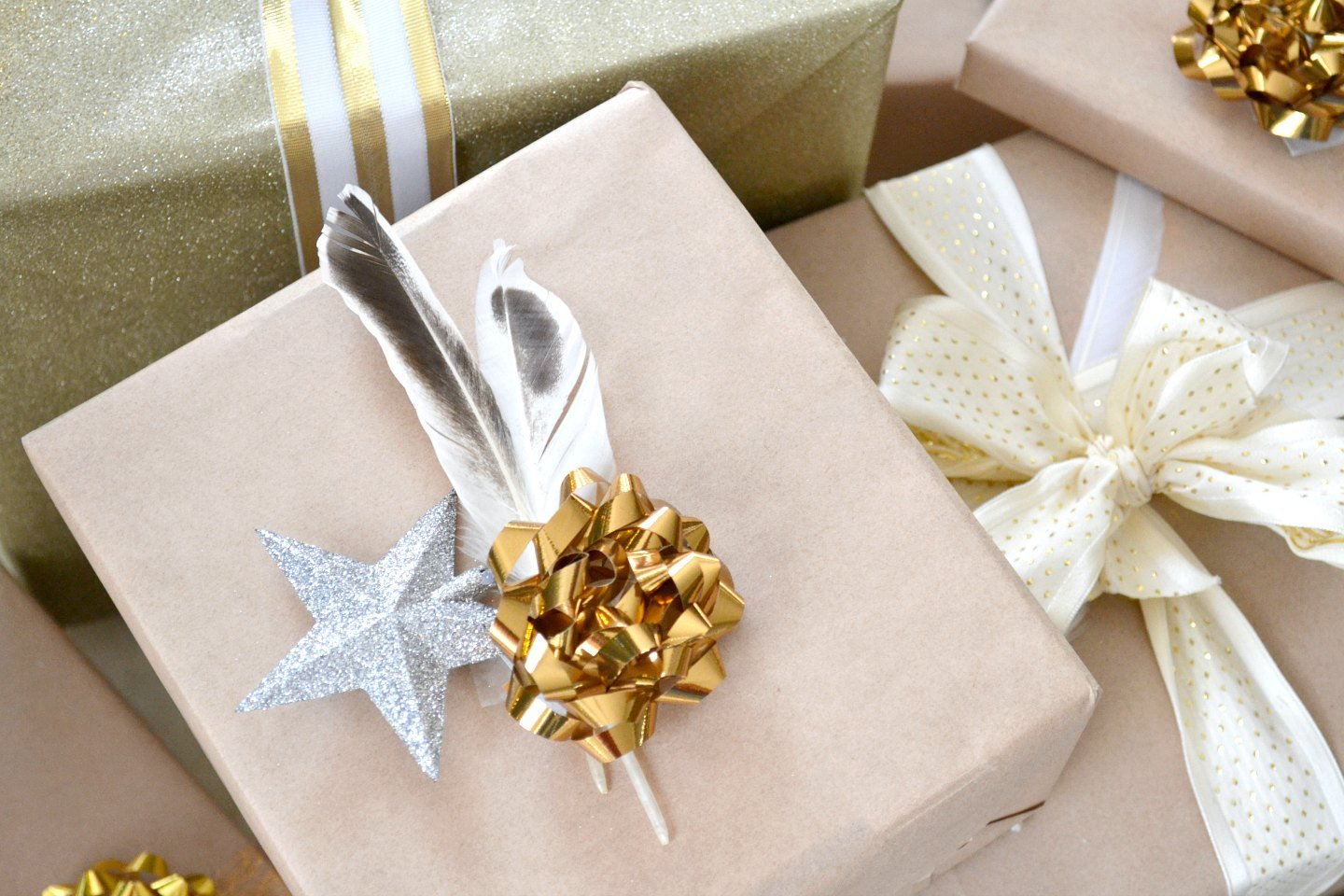 gold and neutrals - woodland theme gift wrapping with feathers