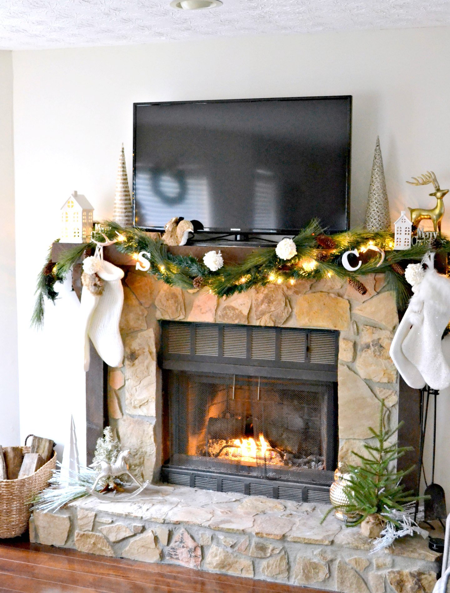 neutral Christmas decor on fireplace mantel