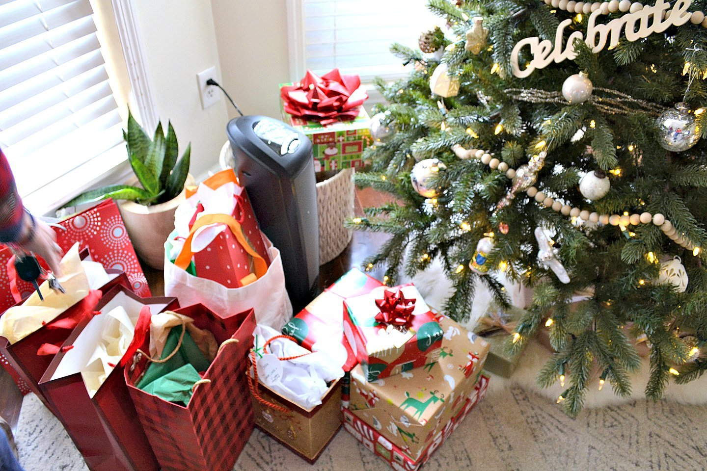 presents in a pile under the tree