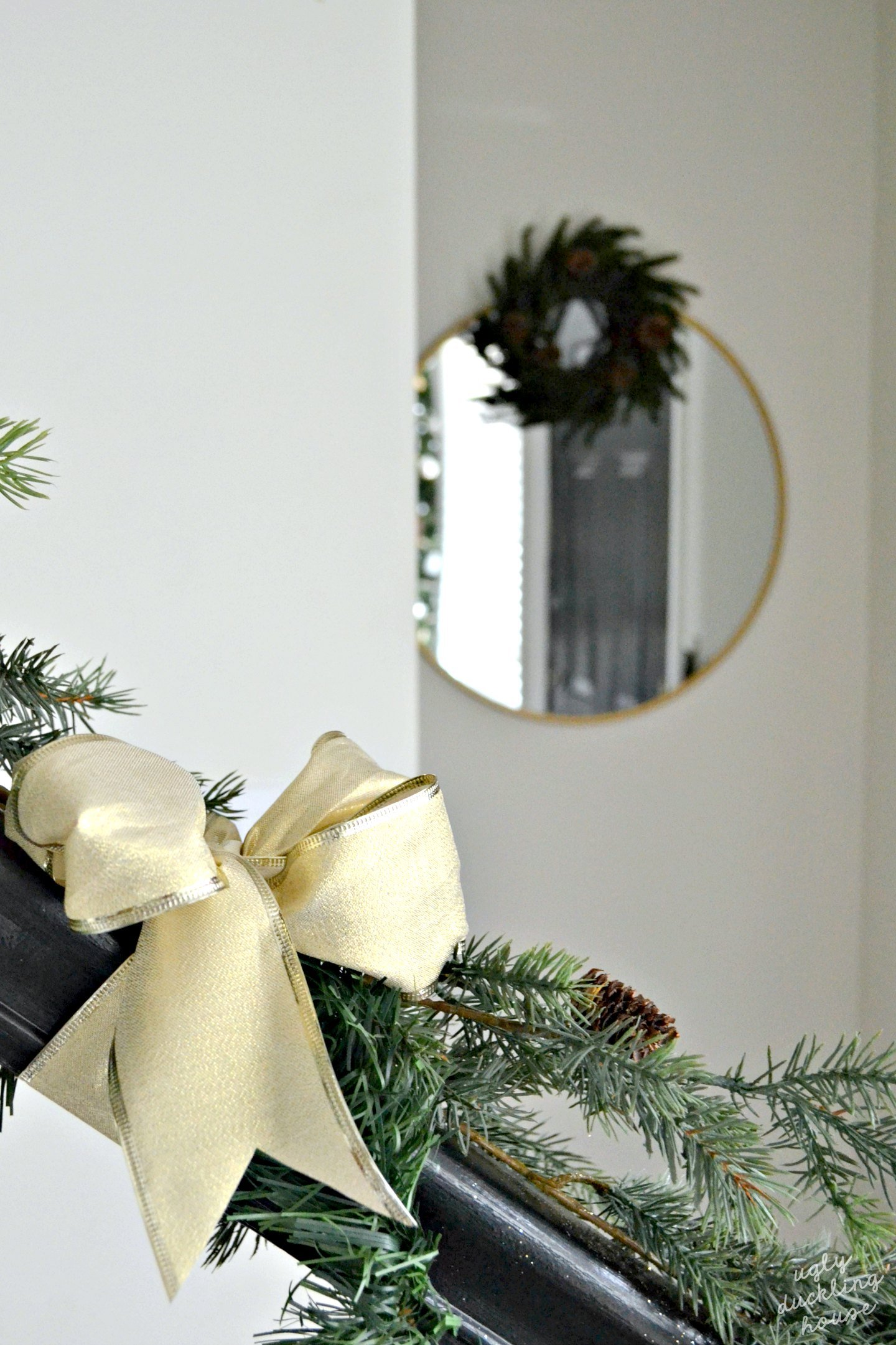 simple neutral christmas entryway with hall mirror