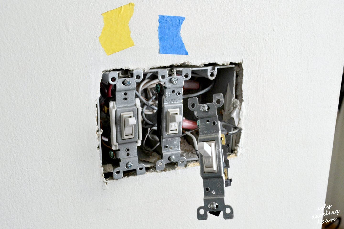 removing old switches to install new ones