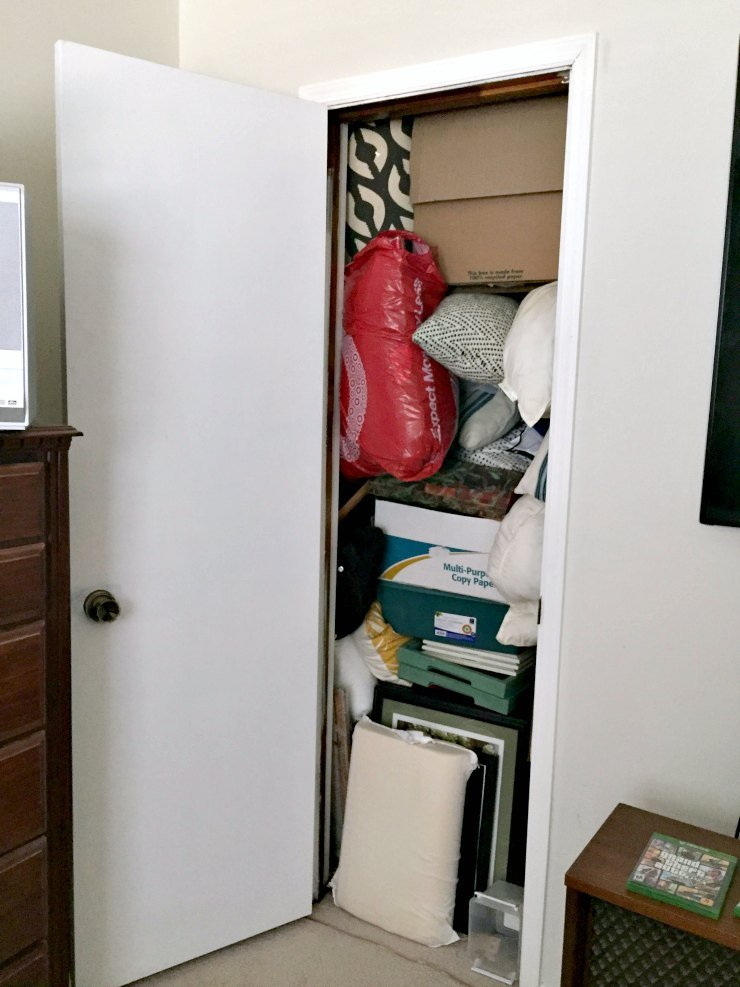 overly crowded closet - guest bedroom