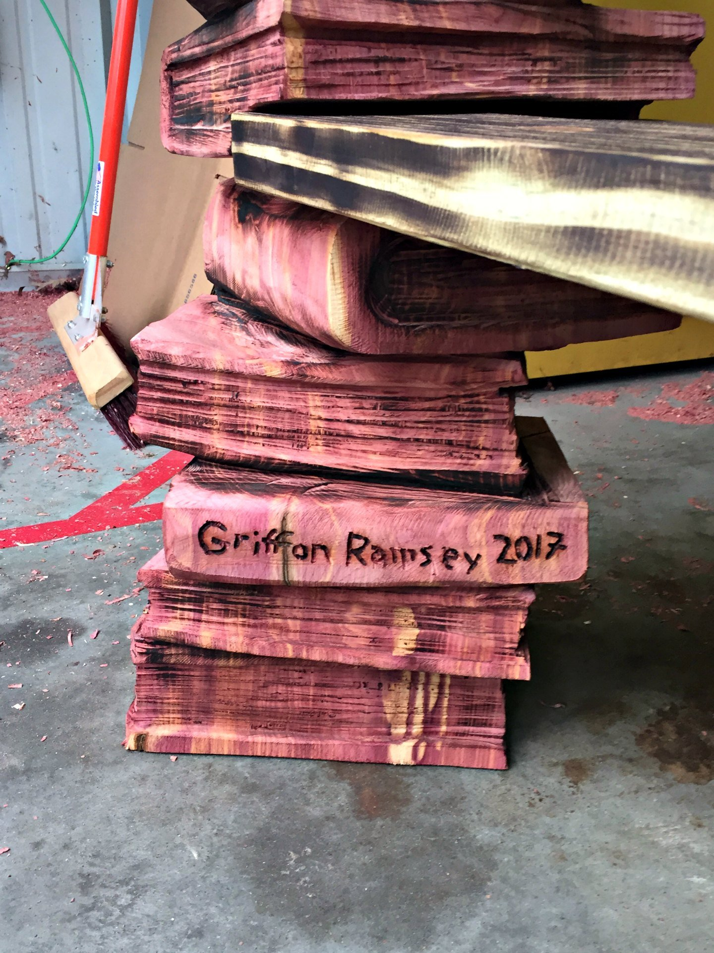 stack of books wood carving by griffon ramsey