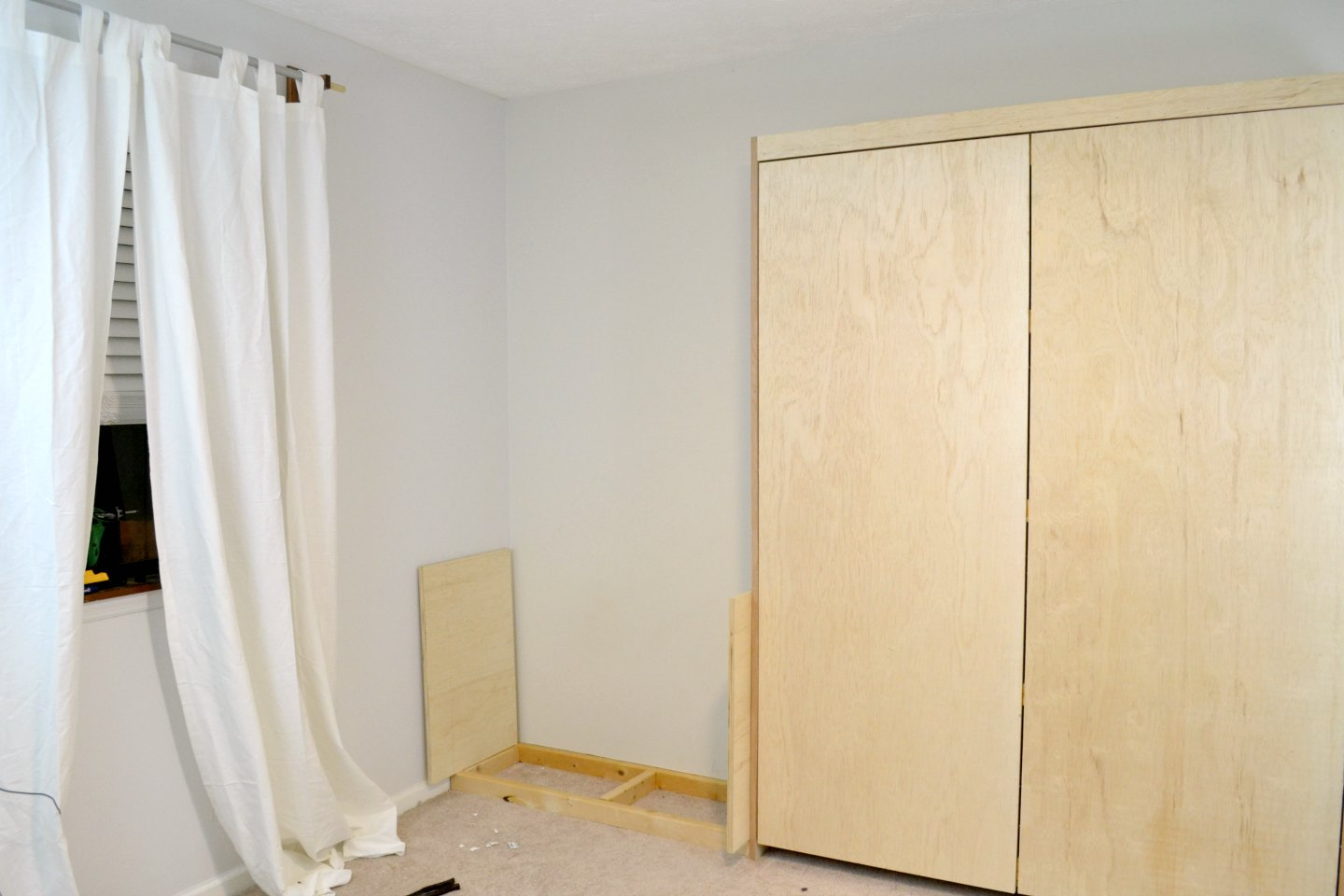 left side of murphy bed with working out details of cabinetry