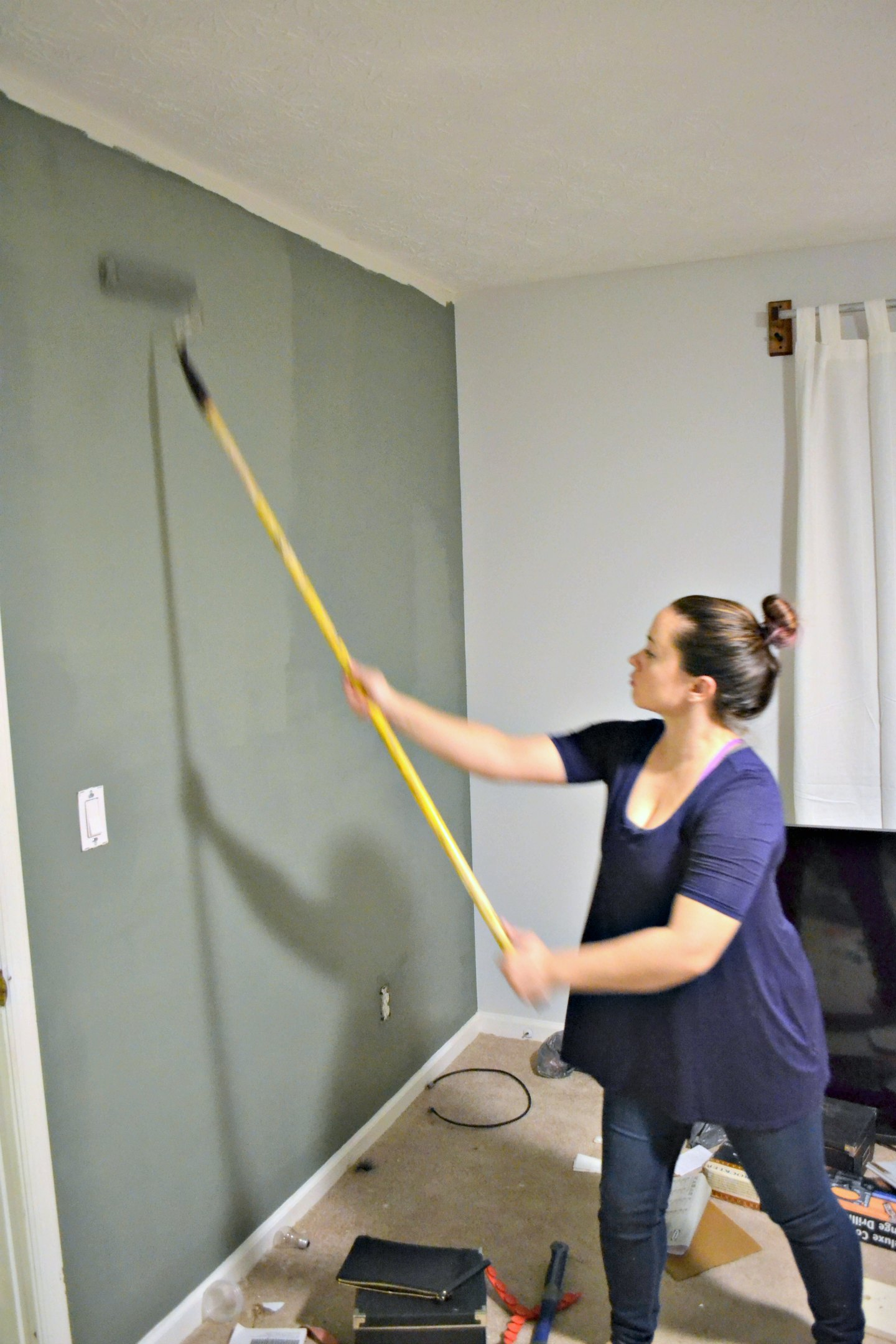 me painting wall in guest bedroom