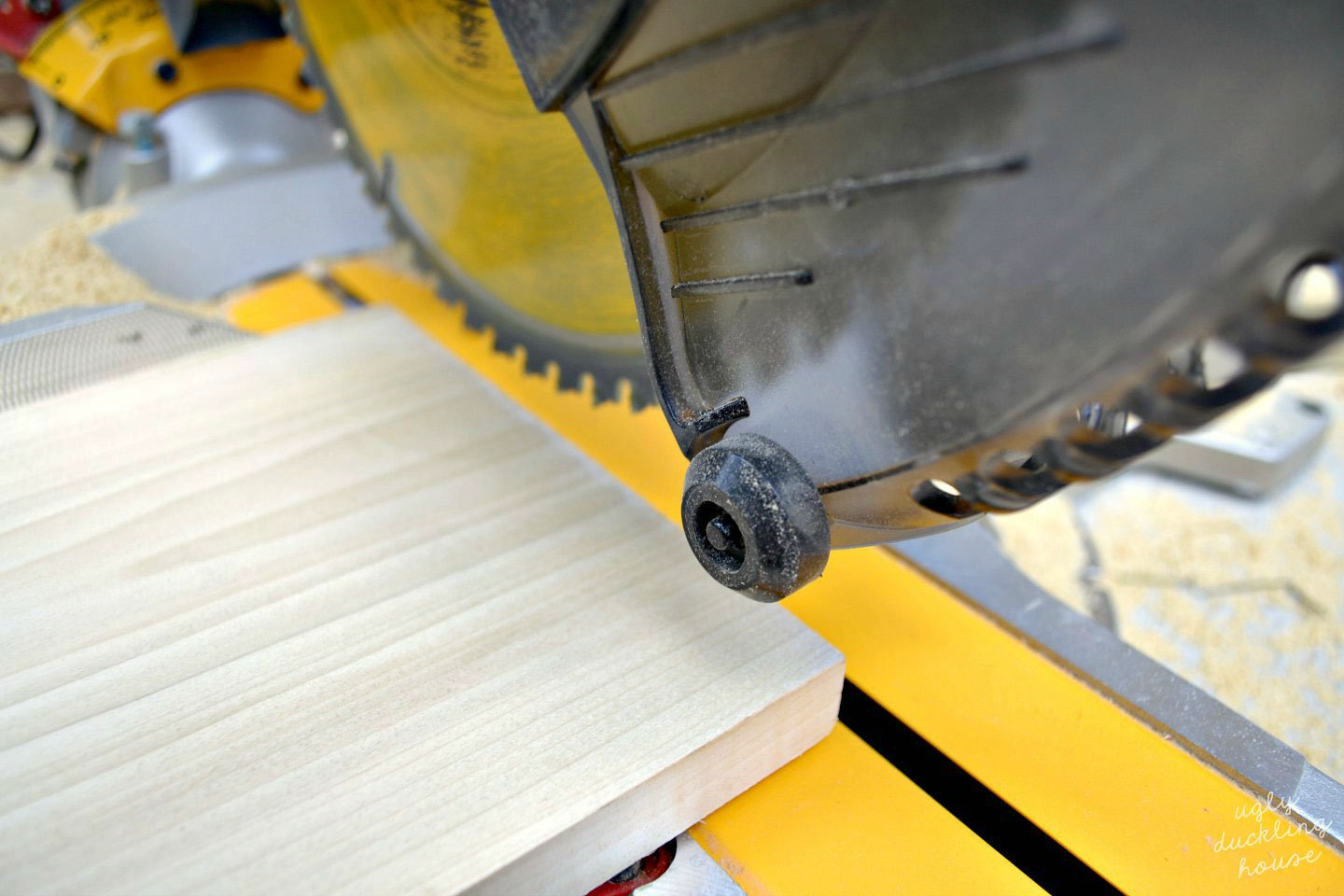 closeup of miter saw cutting wood