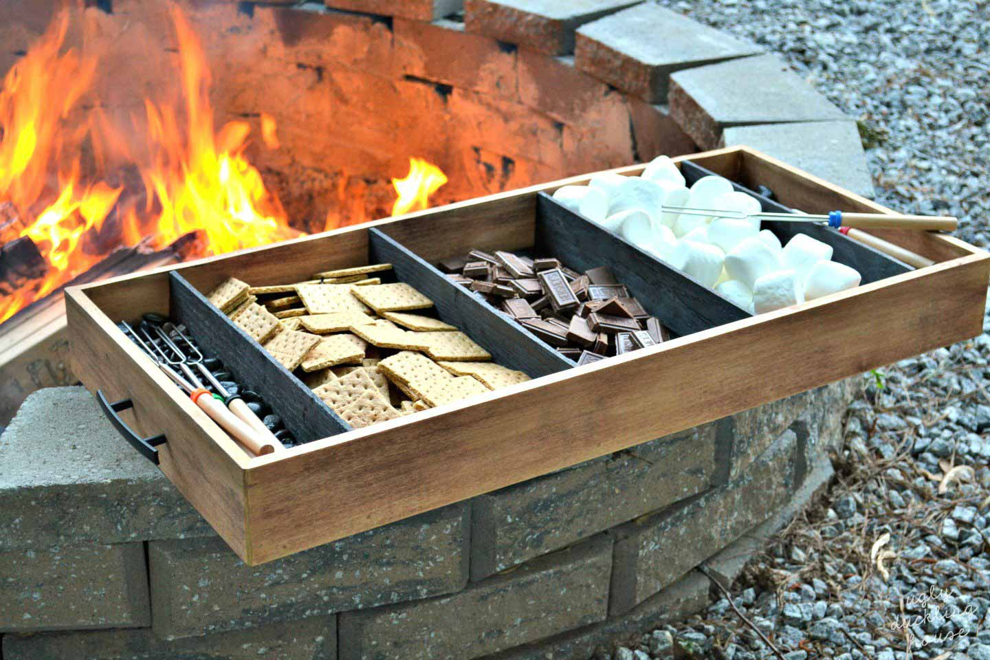 charred wood tray with firepit background