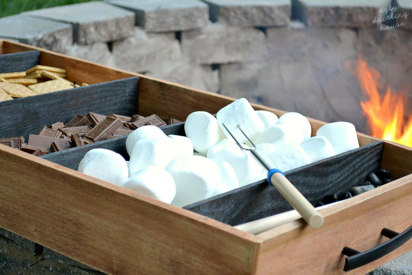 charred wood tray with closeup of marshmallows