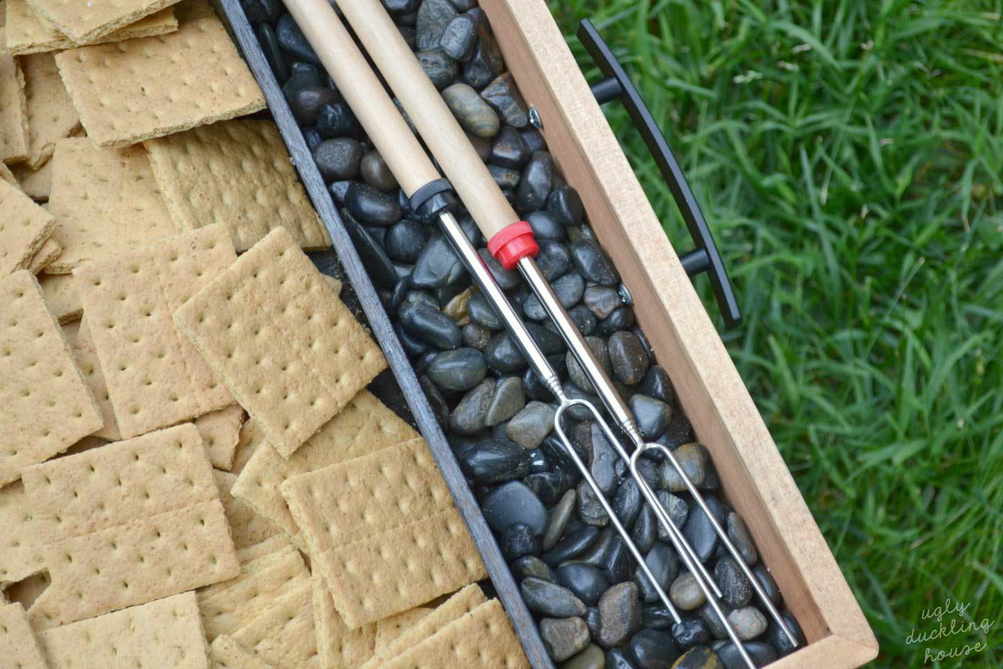 corner of smores tray with roasting sticks